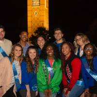 Homecoming court group photo in front of the GVSU clocktower